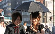 Two people in Japan dressed in red and black gothic lolita fashion